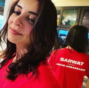 Sarwat Gilani wearing the brand ambassador tshirt for the Special Olympics Pakistan