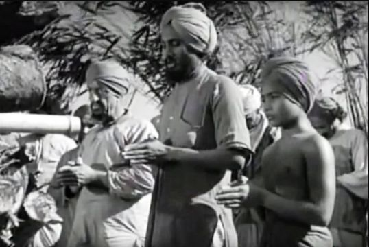 Udham Singh (centre) in a scene from Elephant Boy