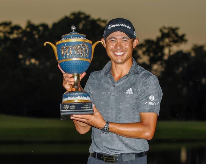 An Image of Collin Morikawa holding a cup for an Achievement in his Golf Career