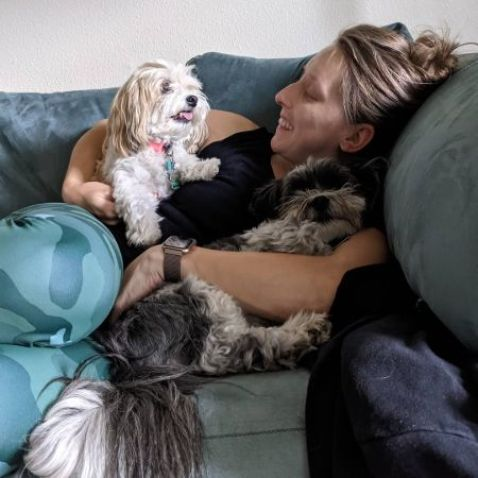 Chelsea Andrews with her puppies