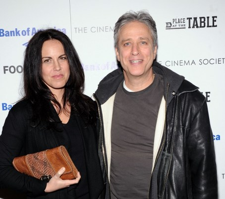 Jon Stewart with his wife