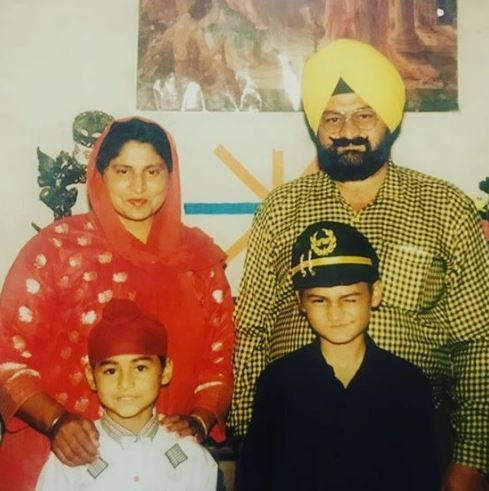 Childhood Photo of Sandeep Singh with his parents and brother