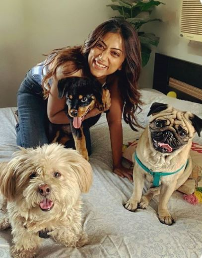 Anandita with dogs