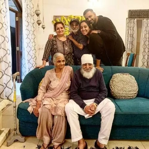 Manshil Gujral with family