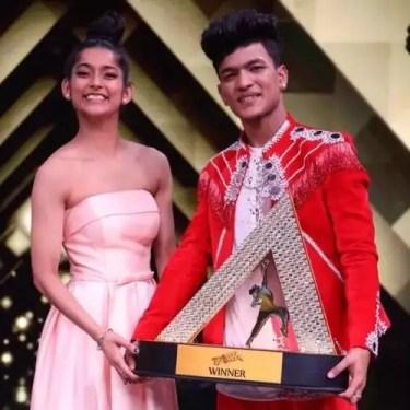Tiger Pop and Vartika Jha with India's Best Dancer Trophy