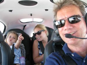 Happy passengers in Cirrus Aircraft SR22