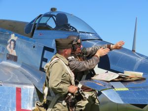 EAA AirVenture 2017, P51 Mustang and two pilots discussing flight tactics, photo credit wikiWings