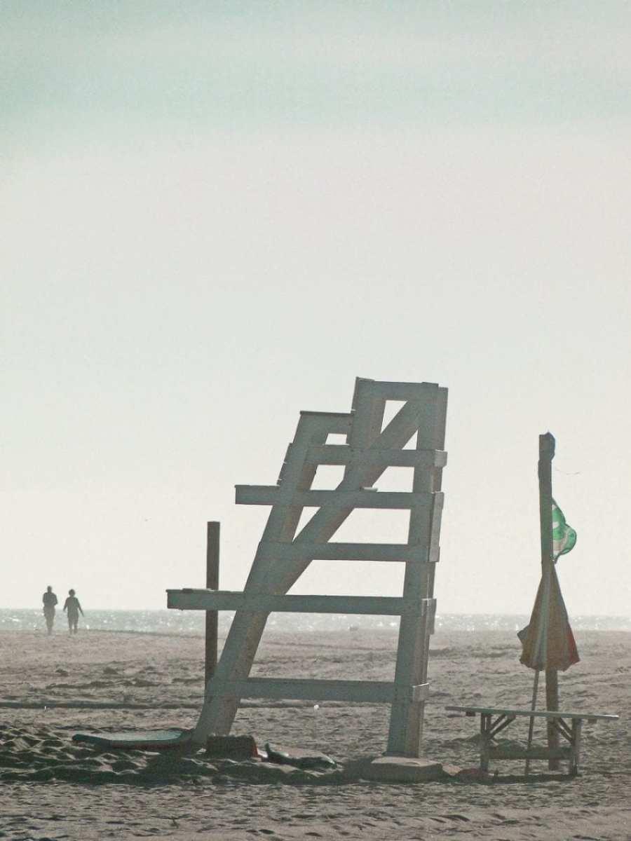 beach walk with kids empty lifeguard chair