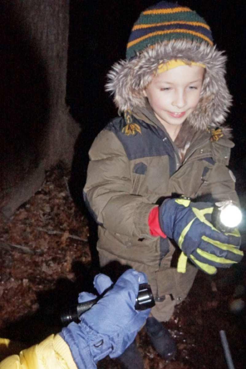 theo holding flashlight