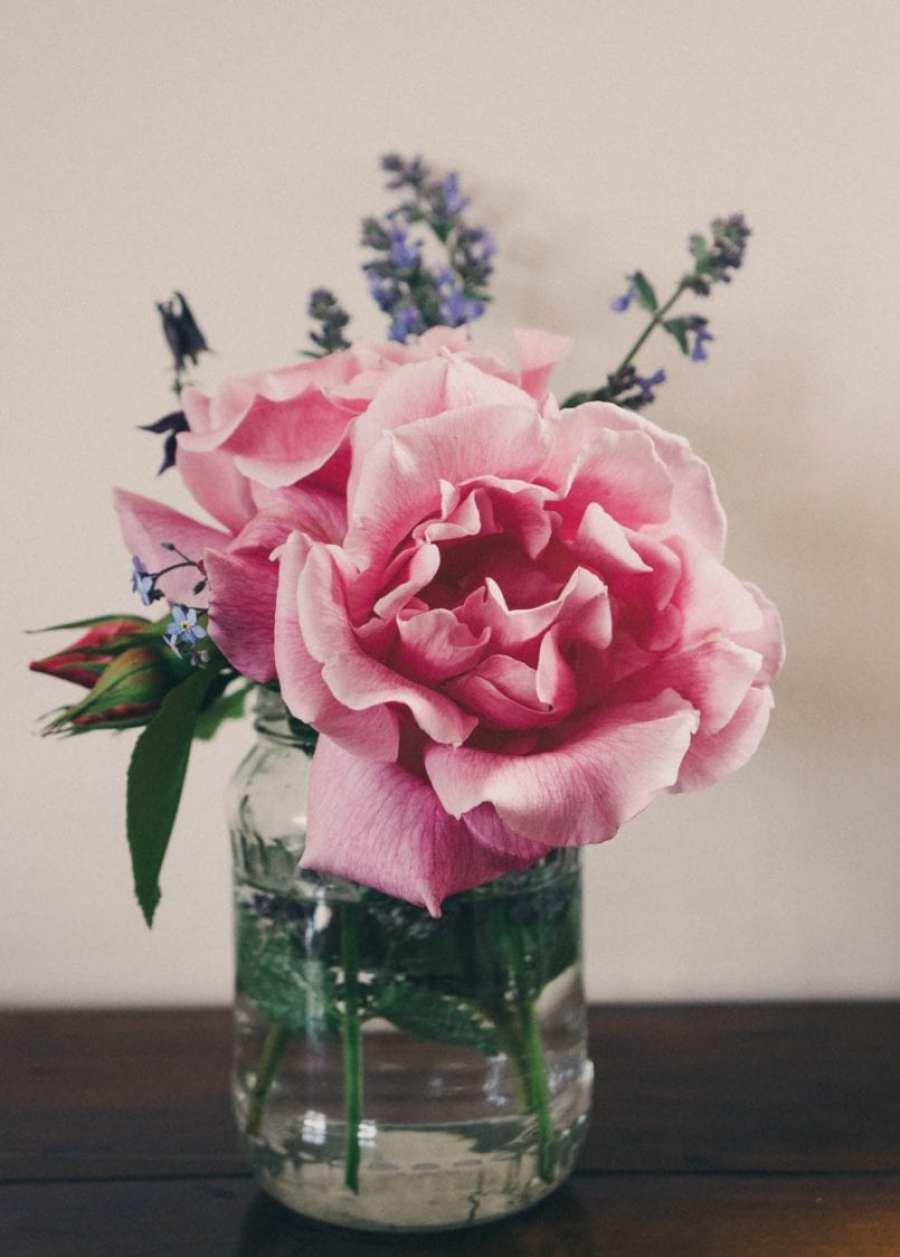 Celebration vase roses and wild flowers
