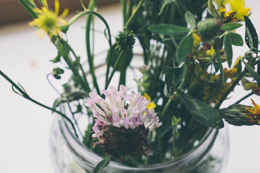 glass jar with wild flowers