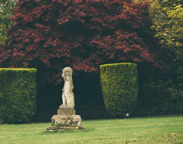 Groombridge Place formal gardens with statue