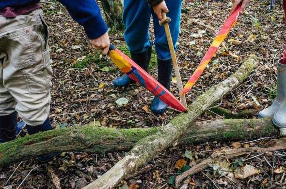 Kids painted swords in woods