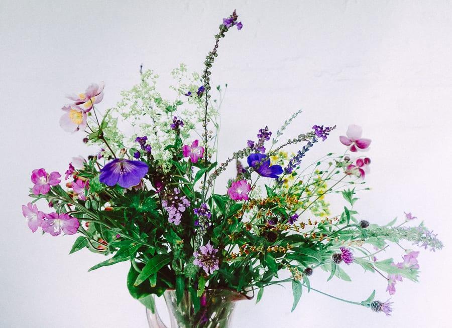 Vase wild and garden flowers