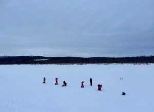 A family enjoying fishing Finnish style