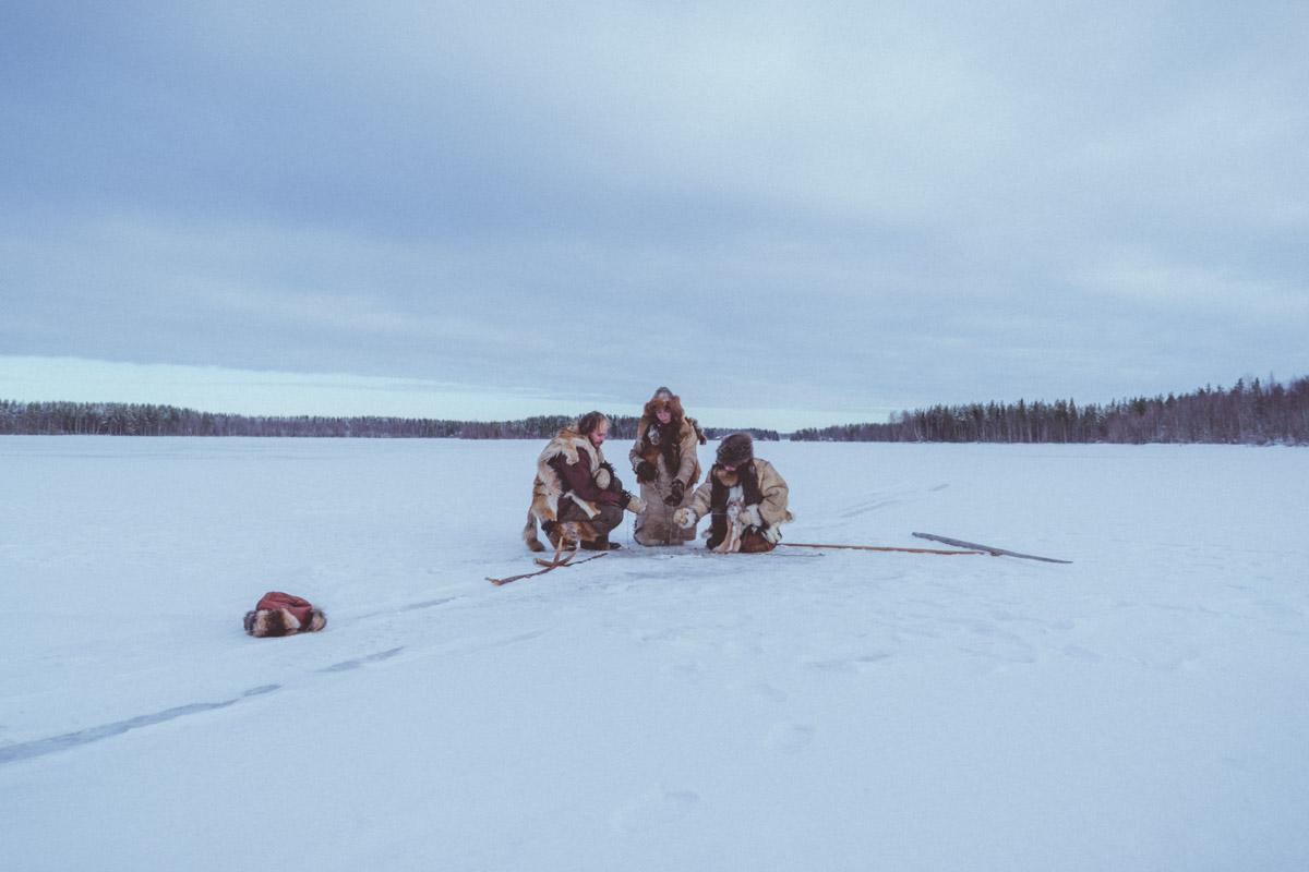 Stone age tribe members ice fishing