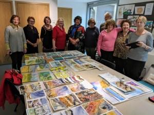 Art course participants with artwork