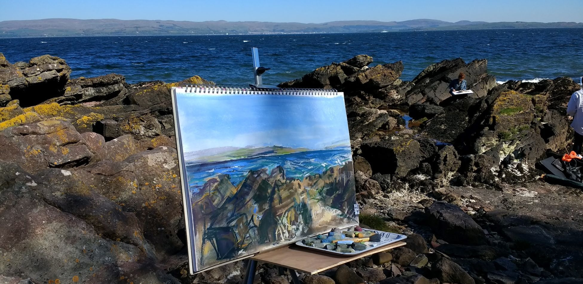 Karen Strang plein air painting on beach in Scotland