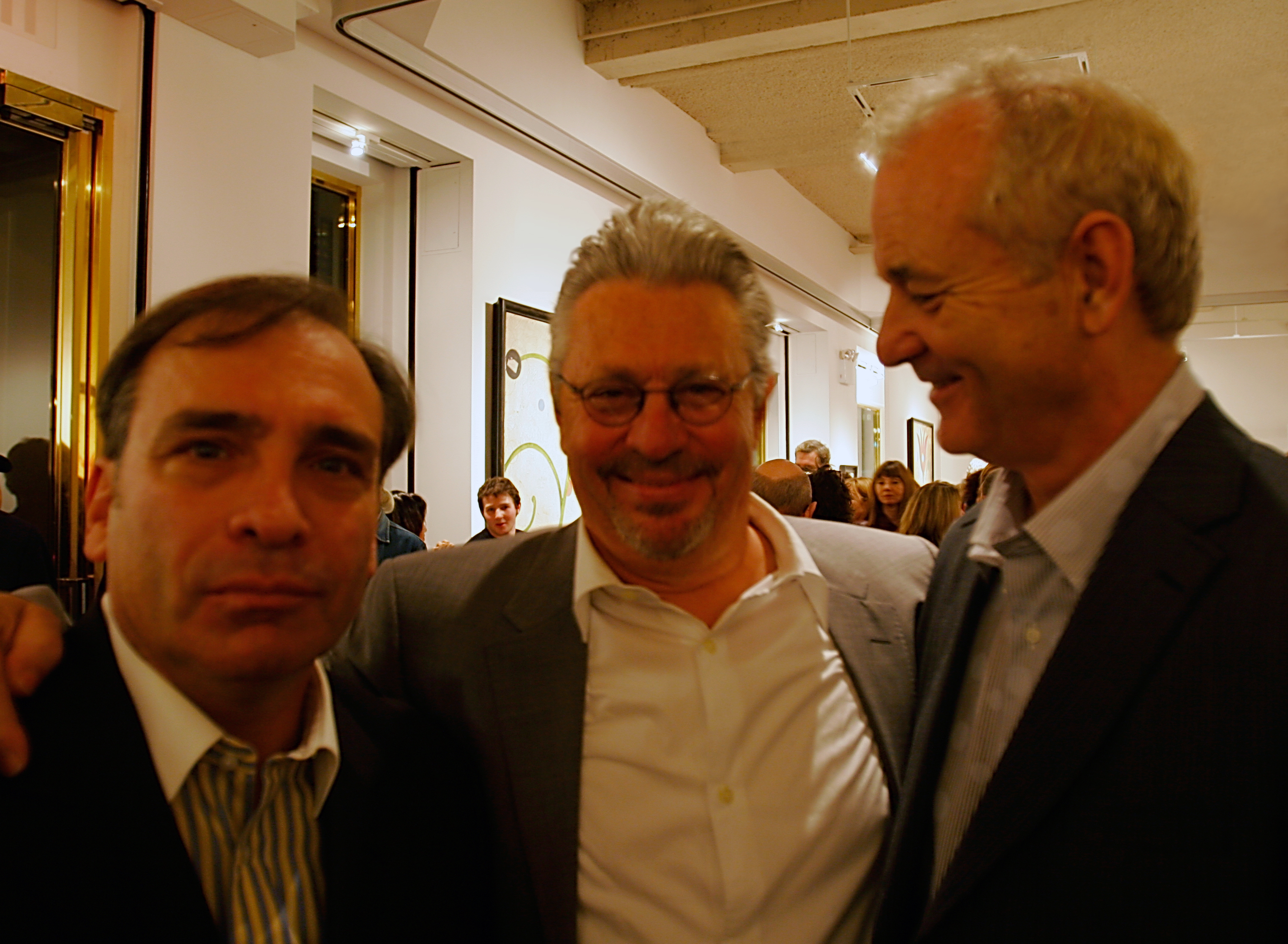 Artist Dan Rizzie in center with actor Bill Murray on right