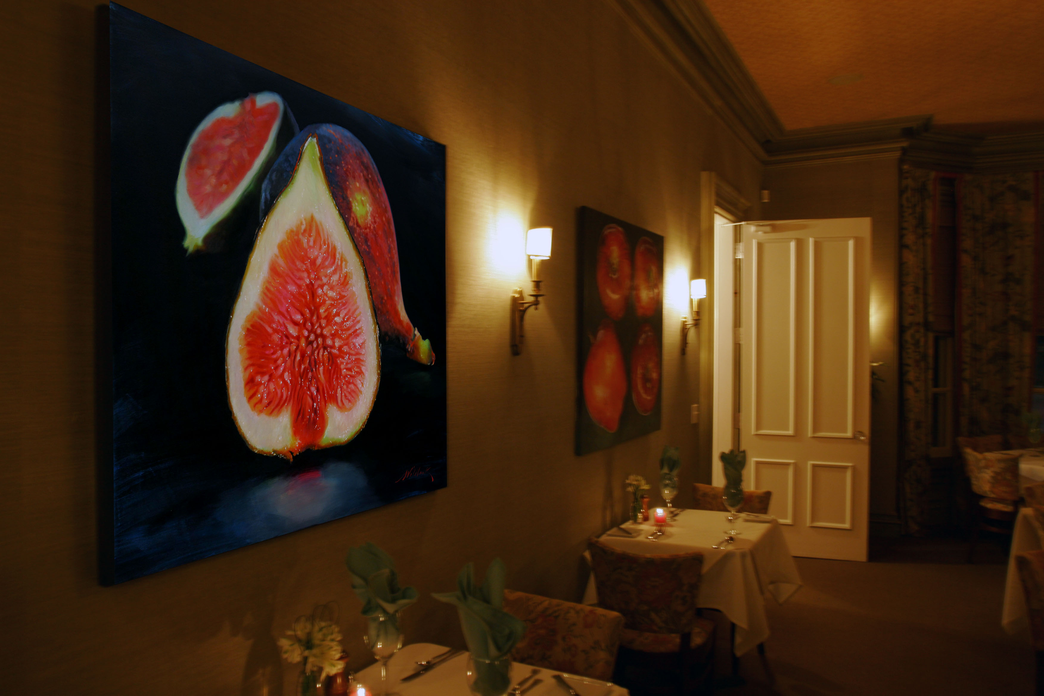 "Still life paintings, ""Figs"" and ""Apples"" by Charles Wildbank in the main dining salon of Jedediah Hawkins Inn"