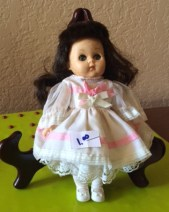 This Ginny doll is fully intact, including her tights and party shoes.