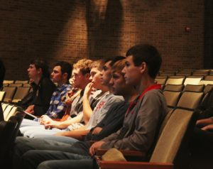 A row of seniors sit together during the aviation speech during homeroom, November 30th.