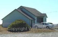 Nesika Beach Cottages Outside