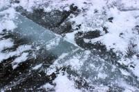 Cracks in Frozen Ice