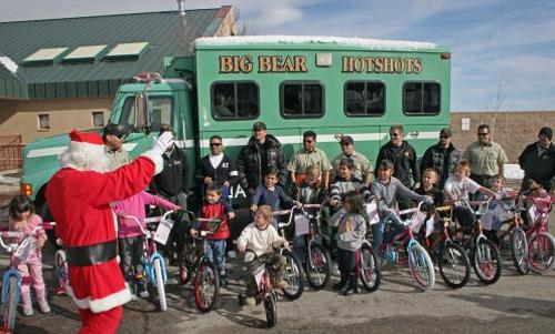 The Big Bear Hot Shots give away 21 bicycles to children at Baldwin Lane Elementary School on Dec. 15.