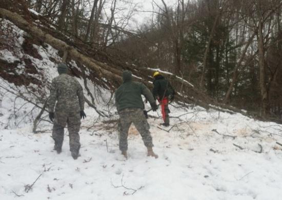 Laguna Hotshots clearing a road in West Virginia