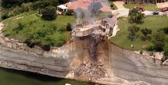 House above lake burning