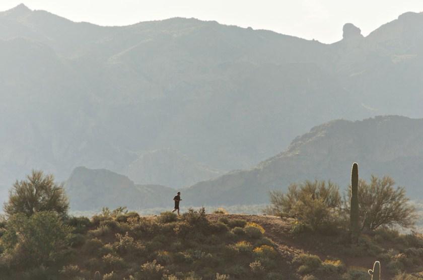 A member of the Mesa Hotshots runs along a ridge line during the crews desert assessment session near the crews base along the Salt River, northeast of the Phoenix metro area.