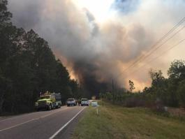 The West Mims Fire burns along Highway 94, near St. George, in this photo posted Monday on InciWeb.