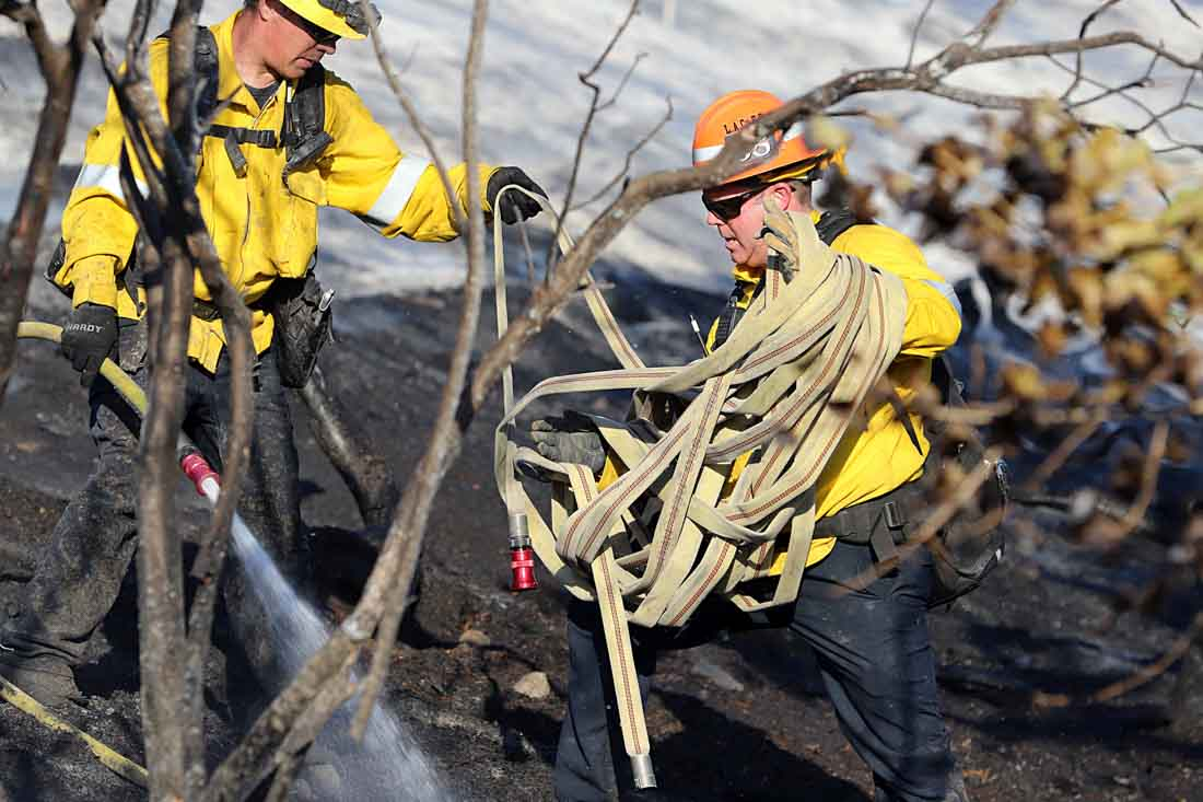 Photos of firefighters at a brush fire in Newhall, California