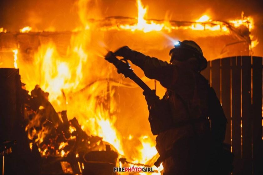 firefighter battles flames Camp Fire