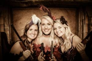 old time photo of three saloon girls