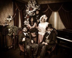 A family dressed up as Southern belles and gentlemen.