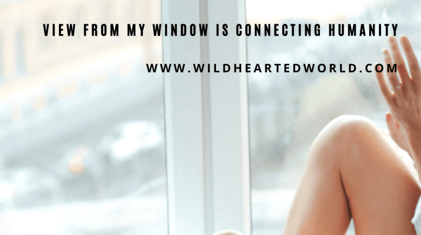 This blog post cover is titled, View From my Window is Connecting Humanity. A womans legs are visible next to a winndow where she has one hand placed. Next to her on the floor is a cup of coffee.