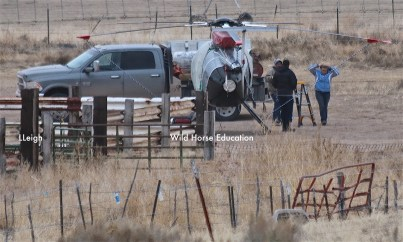 Chopper tied down for wind at departure