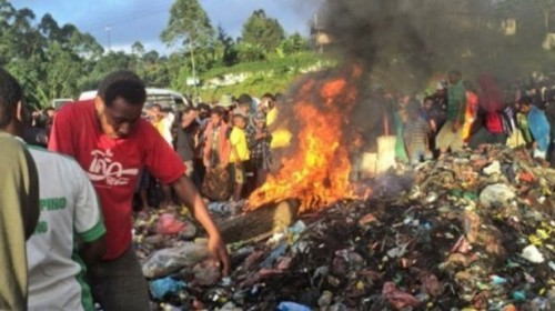 "Kepari Leniata being burnt to death in Papua New Guinea for the crime of ""sorcery."""