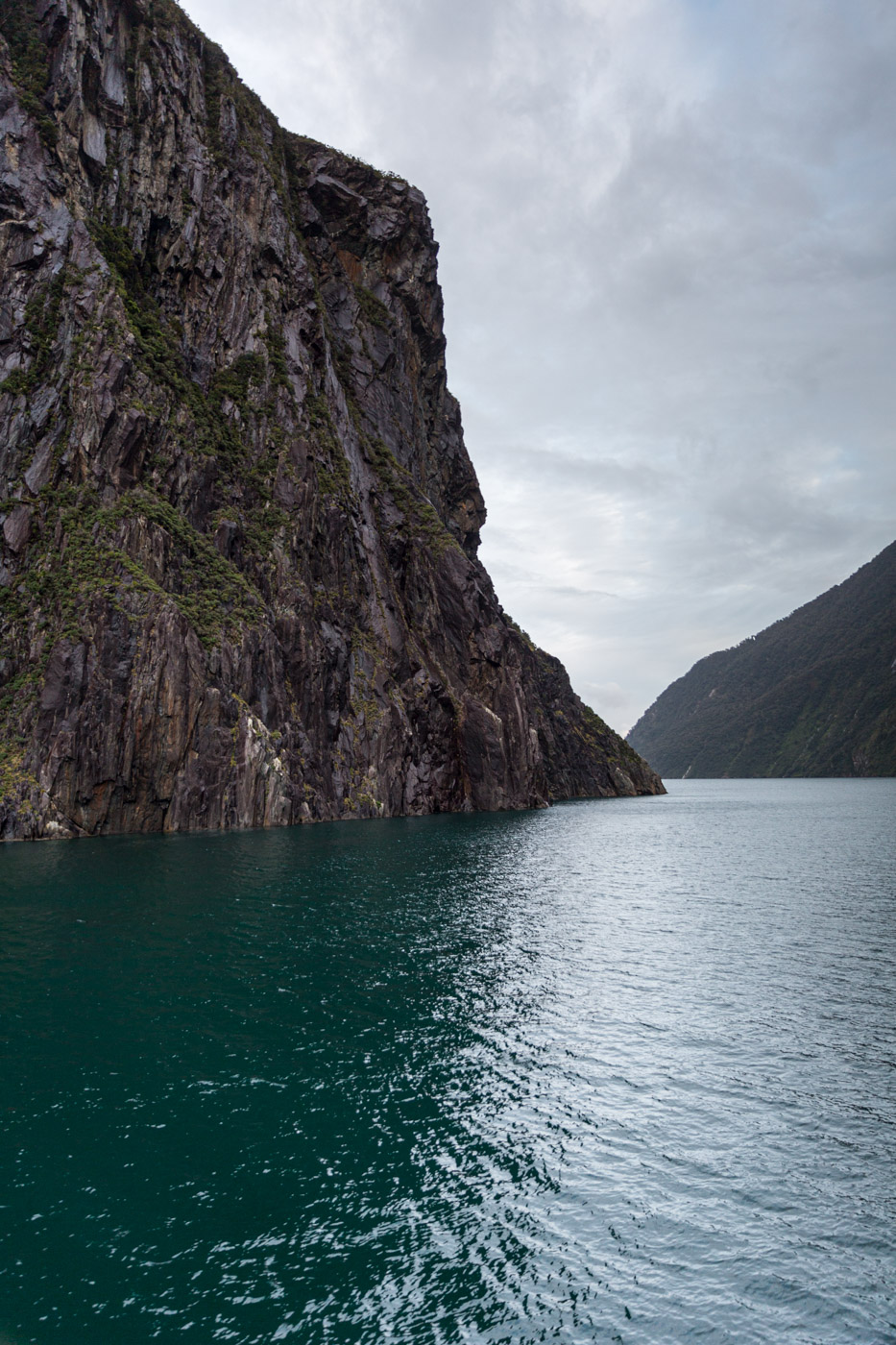 Early morning clouds breaking on our Milford Sound cruise.