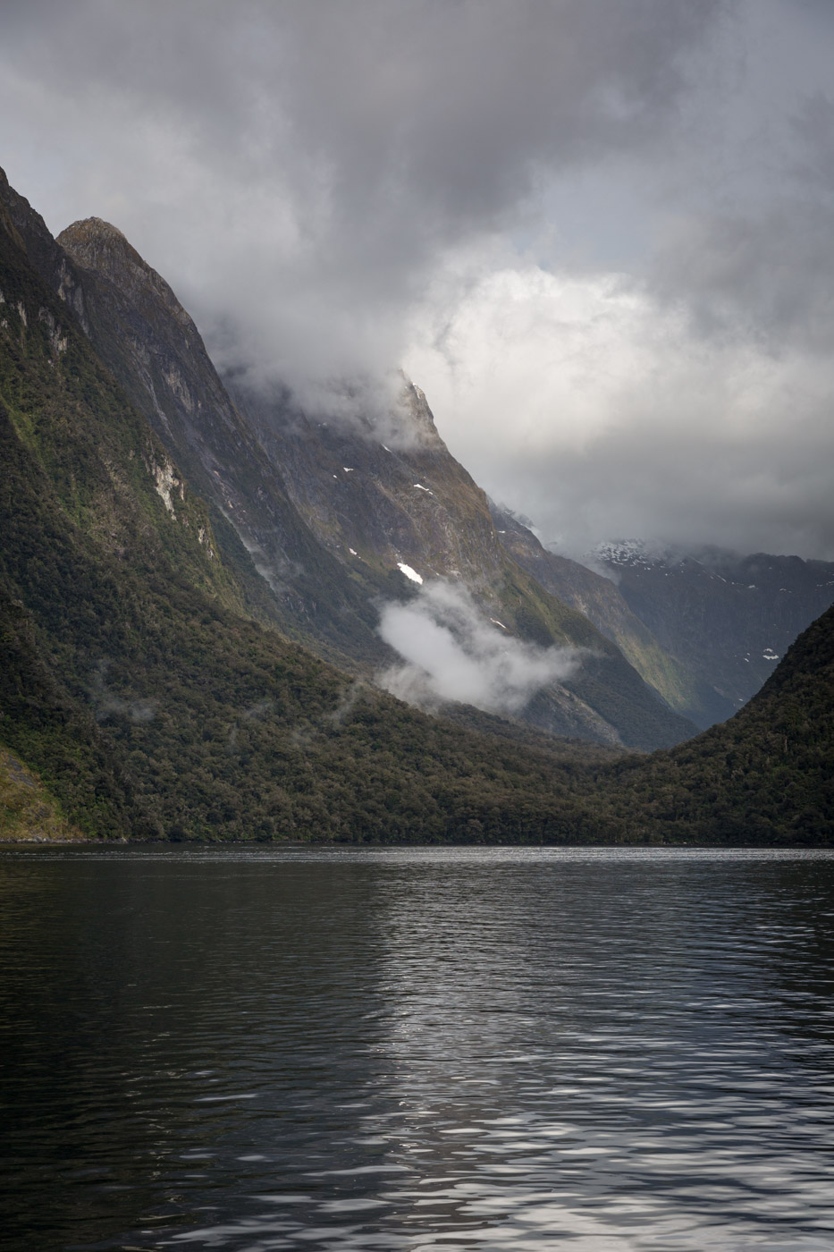 The sun breaks through on our Milford Sound cruise.
