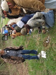 Tim Julien (left) overseeing students learning how to set Collarum traps for coyotes. Photo: Stephen M. Vantassel.