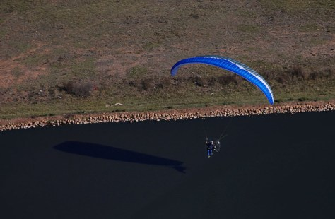 Launching over the settlement dam... I recall mental commentary about being in deep something.  Photo:  The Aerial Perspective