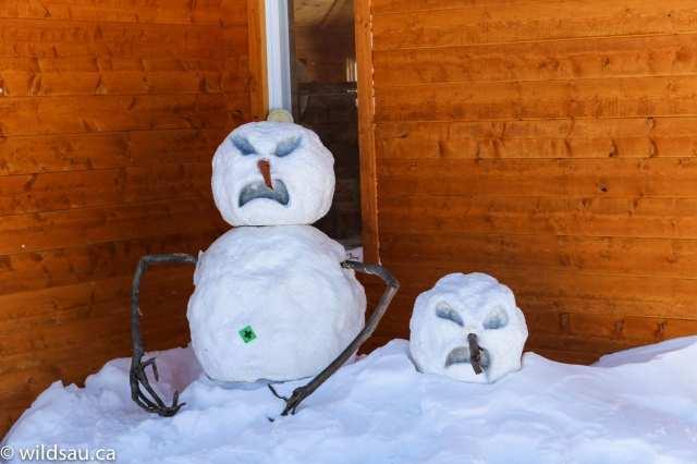 snowmen against lodge