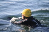 Happy swimmer sets off