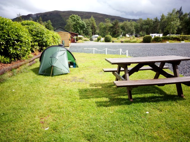 grass pitch, tent and picnic bench at Kinlochewe