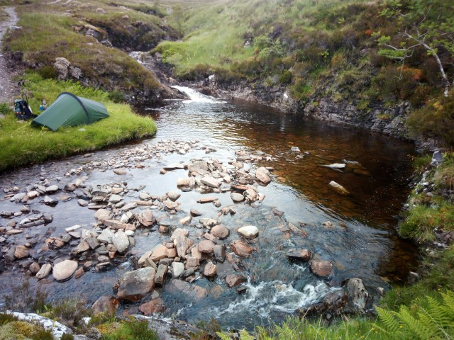 tent pitched by side of river