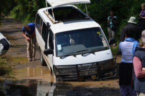 A van stuck in a pothole - it had to be pulled out by a land rover