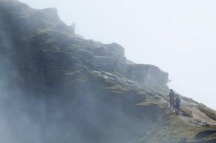 Climbers in the mist below
